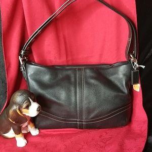 Coach small black handbag in excellant condition